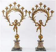Sale 9083N - Lot 56 - A pair of superb gilt bronze cherub form candelabra with green marble bases. Height 81cm