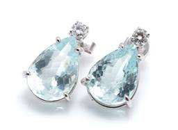 Sale 9253J - Lot 436 - A PAIR OF 18CT WHITE GOLD AQUAMARINE AND DIAMOND EARRINGS; each claw set with a pear cut aquamarine (1 with tiny chip on crown) and...