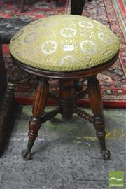 Sale 8255 - Lot 1035 - Early 20th Century American Piano Stool, with round padded seat & claw feet