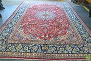 Sale 8282 - Lot 1057 - Persian Kashan, with central medallion and arabesques (412 x 395cm).