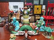 Sale 8455 - Lot 1060 - Group of Ceramic Garden Ornaments inc Pair of Buddhas, Dragon , Tower & 2 Pagodas