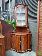 Sale 8485 - Lot 1022 - Baroque Style Walnut Corner Cabinet, with broken arched pediment, above a glass panel door, with carved brackets below & two bowed m...
