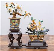 Sale 8650A - Lot 73 - A Chinese miniature floral display of Champlevé jardinières and semi precious stones modelled as flowers on a timber stand, total He...