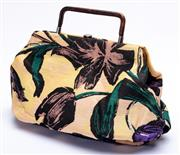 Sale 8921 - Lot 53 - A VINTAGE MARNI FABRIC HANDBAG; floral pattern with leather trim, hard frame and handle, size 38 x 25 x 8cm, with dust bag.