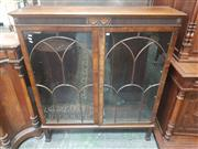 Sale 8917 - Lot 1028 - Georgian Style Mahogany Bookcase, with reeded frieze & two arched astragal doors, raised on tapering legs (Key in Office)
