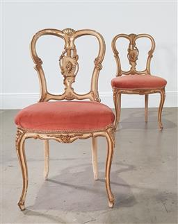 Sale 9255 - Lot 1064 - Pair of heavily carved dining chairs (h:87 x w:45 x d:45cm)