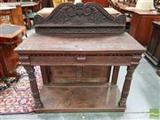 Sale 8485 - Lot 1039 - Antique Oak Serving Table, with carved back & drawer, on turned legs joined by a plinth (alterations)