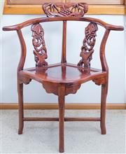 Sale 8515A - Lot 58 - An Oriental rosewood corner chair with yoke back and carved flora and fauna