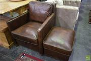 Sale 8523 - Lot 1036 - Impressive Leather Armchair with Ottoman