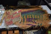 Sale 8563T - Lot 2580 - Tribal Fibre, Coloured Skirt with a Fibre String Bag & a Collection of Bamboo & Wooden Spears