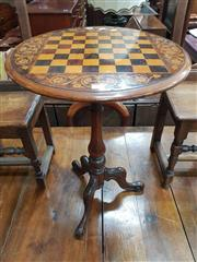 Sale 8868 - Lot 1102 - Victorian Walnut Marquetry Chess or Games Table, with round walnut veneered top, the board in rosewood and pine, on a turned pedestal