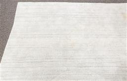 Sale 9150H - Lot 61 - An ivory coloured floor rug with blue brush effect, 233cm x 340cm, some stains apparent