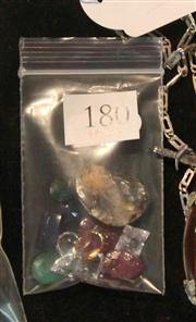 Sale 8050B - Lot 64 - A PARCEL OF UNSET GEMSTONES; a blue, yellow and 4 white sapphires (synthetic), 2 emeralds, a dark violet cabochon opal (chipped), a...