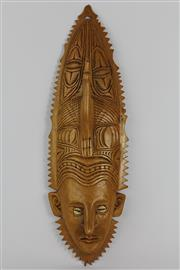 Sale 8520T - Lot 41 - Carved wall mask with cowrie eyes and protruding nose. Serrated carved edge L 48 cm x W 15 cm
