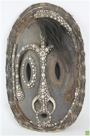 Sale 8568 - Lot 44 - Carved Tribal Mask with Shell and Feather Decorations (some losses to head, missing pieces included)