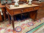 Sale 8693 - Lot 1077 - Regency Mahogany Desk, the low gallery back with scrolled ends, having two drawers, turned reeded legs to front, plain turned at bac...