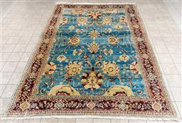 Sale 9130H - Lot 5 - A Robyn Cosgrove Turkish handknotted Sultanabad carpet with stylised floral design on a blue ground, 286cm x 399cm
