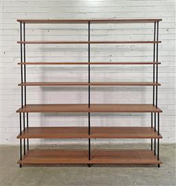 Sale 9151 - Lot 1095 - Vintage open bookshelf with 7 graduating teak shelves supported by tubular metal frame and brass fittings (h188 x w.183 x d.35cm) -