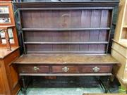 Sale 8500 - Lot 1085 - Possibly Georgian Oak Dresser, with open shelves, three drawers & turned legs (alterations)
