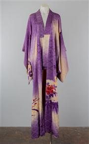 Sale 8740F - Lot 128 - A Japanese handsewn purple silk kimono depicting cherry blossoms, bamboo leaves and peonies (botan), stamped to the back with the em...