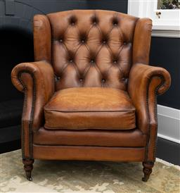 Sale 9248H - Lot 113 - An aged leather libarary chair with button back and scrolled arms.  RRP $4400.