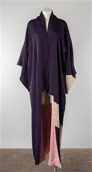 Sale 8740F - Lot 206 - A Japanese handsewn silk kimono of deep purple with subtle lamé threading, with a contrasting swirl print to sleeves and lower half,...