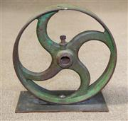 Sale 7968B - Lot 1 - Mounted cast iron industrial wheel painted green