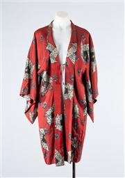 Sale 8685F - Lot 80 - A Japanese handsewn silk kimono of red ground with abstract spiral design with a constrasting lining of chrysanthemum, cherry blosso...