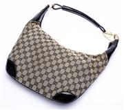 Sale 8921 - Lot 22 - A GUCCI MONOGRAM CANVAS HOBO BAG; GG canvas material with black patent leather trim and gold tone hardware, black interior material...