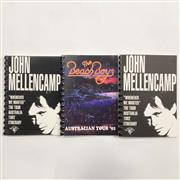 Sale 8926M - Lot 52 - Two John Mellencamp Whenever We Wanted 1992 Australian Tour Itinerary together with a Beach Boys 1992 Australian Tour Itinerary