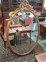 Sale 8917 - Lot 1059 - Large 19th Century Louis XVI Style Gilt Oval Mirror, the moulded frame surmounted by a bow & laurel leaves