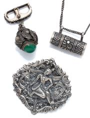 Sale 9046 - Lot 324 - THREE VINTAGE TRIBAL SILVER JEWELLERY ITEMS; a chrysoprase set pendant on enhancer slide with wire twist decoration, size 45 x 30mm,...