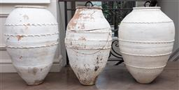 Sale 9130H - Lot 67 - Three terracotta olive jars with distressed white ashed finish (two damaged one repaired), tallest Height 86cm