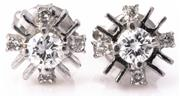 Sale 8937 - Lot 366 - A PAIR OF 14CT WHITE GOLD DIAMOND STUD EARRINGS; each centring an approx. 0.13ct round brilliant cut diamond above a starburst surro...