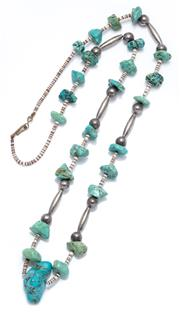 Sale 9012 - Lot 329 - A SILVER TURQUOISE NECKLACE; strung with 13 - 29mm freeform turquoise beads, small stiped glass rondels and round silver and tubular...