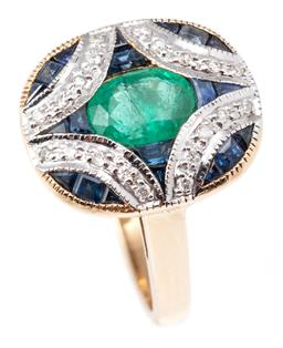 Sale 9124 - Lot 407 - A 9CT GOLD DECO STYLE EMERALD DIAMOND AND SAPPHIRE RING; centring an oval cut emerald surrounded by mixed cut blue sapphires and 20...