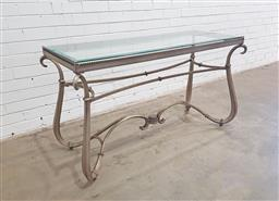 Sale 9126 - Lot 1261 - Glass top hall table over metal scrolled base (h:74 x w:132 x d:41cm)