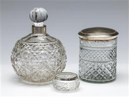 Sale 9164 - Lot 188 - A hallmarked sterling silver topped condiment jar with an perfume bottle - mismatched lid (H:11cm and 12cm)