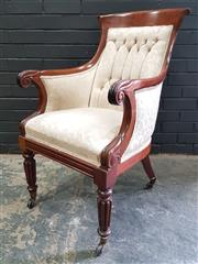 Sale 8993 - Lot 1083 - George IV Mahogany Armchair, with cream buttoned upholstery, scrolled arms & turned reeded legs on brass castors (restoration to one...