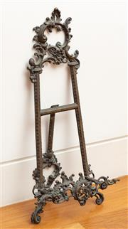 Sale 9044H - Lot 8 - A small metal easel with foliate scrolls and leaf design, Height 55cm
