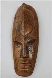 Sale 8520T - Lot 43 - Carved Mask with Embossed turtle to forehead 31 cm x 10.5cm