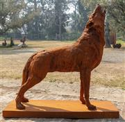Sale 8871H - Lot 7 - A cast iron howling wolf in rust finish, height 117, length 126cm