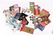 Sale 9015 - Lot 36 - A Collection of Australian Uncirculated $1 and 50cent Coins and 3 x Coin Sets, all in packaging, plus 13 x 50 cents.