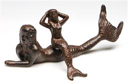 Sale 9238 - Lot 81 - A cast iron figure of a lounging mermaid together with a figure of a seater example (L:22cm and 13cm)
