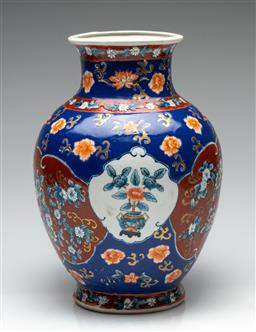 Sale 9190H - Lot 170 - A Chinese blue ground ceramic vase decorated with floral bursts, Height 31cm, chip to base