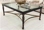 Sale 8868H - Lot 15 - A glass and brass coffee table in the Empire style on paw feet, Height 46cm, Width 82cm, Length 122cm