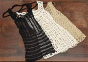 Sale 9027F - Lot 21 - A crochet mini dress by Anna Kostarova with two other similar examples, all size S