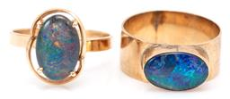 Sale 9132 - Lot 308 - TWO GOLD OPAL RINGS; a 10ct 2.5mm wide band and 9ct 8mm wide band, both set with opal triplets (1 chipped), sizes Q & N, total wt. 6...