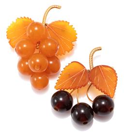 Sale 9156J - Lot 348 - TWO VINTAGE AMBER BROOCHES; each a gilt bar brooch one a bunch of grapes with vine leaves, 55 x 45mm, other attached with 2 leaves a...