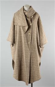 Sale 8740F - Lot 22 - A Rusk & Finch woolen cape coat with wrap-around shawled neck in a chequered houndstooth, size XL